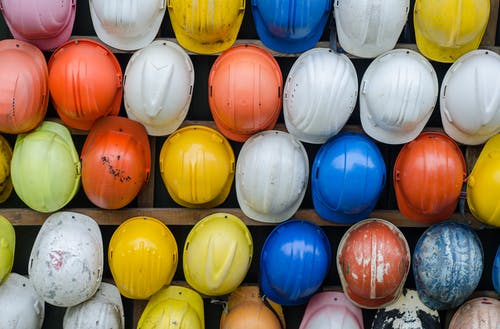 This image has an empty alt attribute; its file name is hard-hats.jpeg